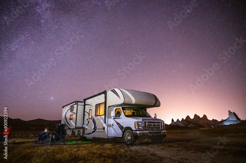 Campers gaze at Milky Way by their RV Fototapeta