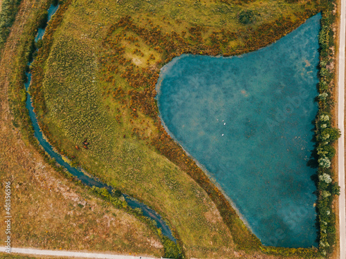 Stampa su Tela Aerial drone shot of the top-down view of the small lake