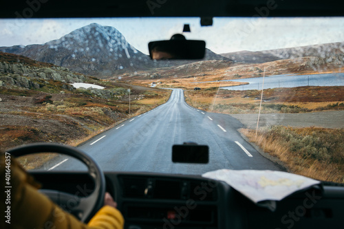 Murais de parede Focus on view from inside adventure car or camper van on amazing cinematic scandinavian landscape