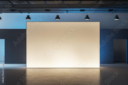 Fototapeta Modern museum interior with illuminated billboard