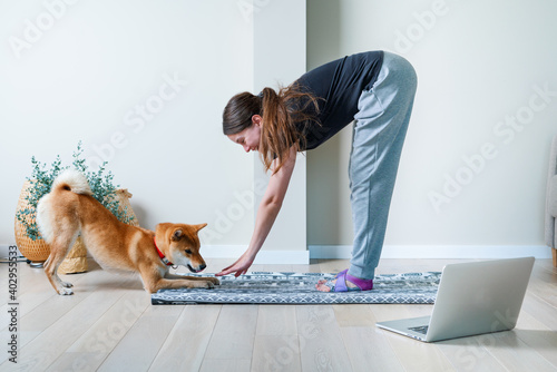 Doga or Doga yoga is the practice of yoga as exercise with dogs Fototapet