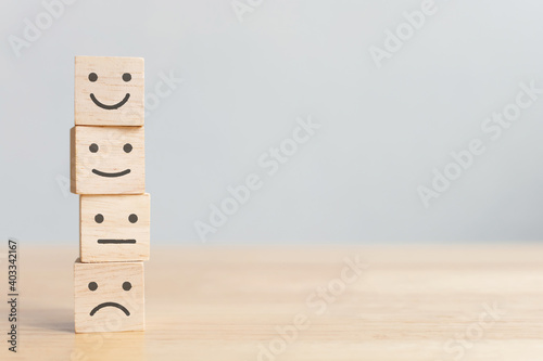 Tela Wooden blocks with icon happy face smile symbol on wood table, evaluation, Incre