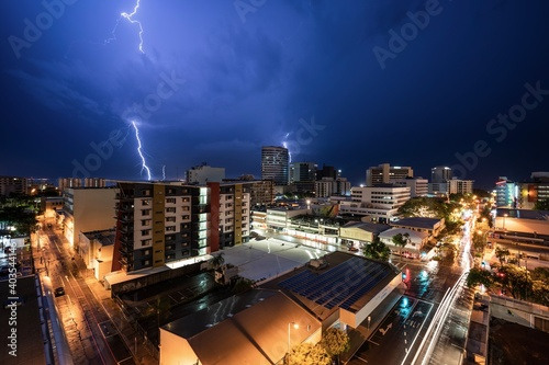 Leinwand Poster Double lightning strike in Darwin city during a wet season storm