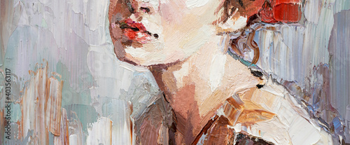 Fotografia, Obraz .Fragment of a portrait of a young beautiful girl with red lips. Oil painting on