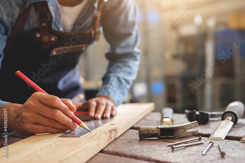 Fotografering Midsection Of Carpenter Working At Workshop