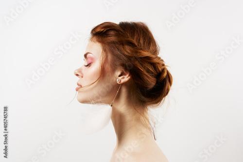 emotional woman bare shoulders fluffy earrings luxury clear skin light background