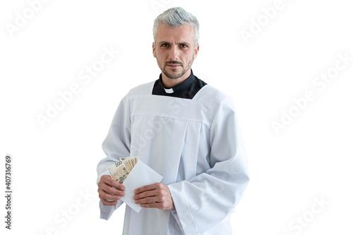 Obraz na plátně Polish catholic priest holding Polish money zloty during pastoral visit in Poland