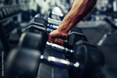 Fotografija Rows of dumbbells in the gym with hand
