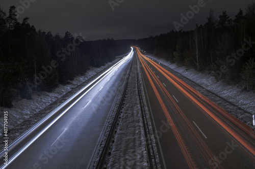 Canvas Print Long exposure of a road with light trails of passing vehicles