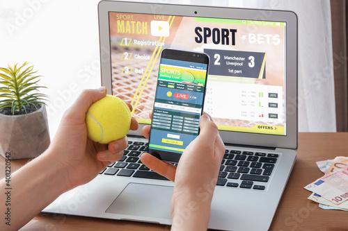 Slika na platnu Man placing sports bet at home