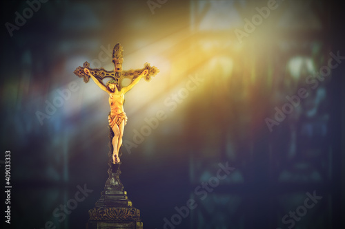 Fotomural crucifix, jesus on the cross in church with ray of light from stained glass