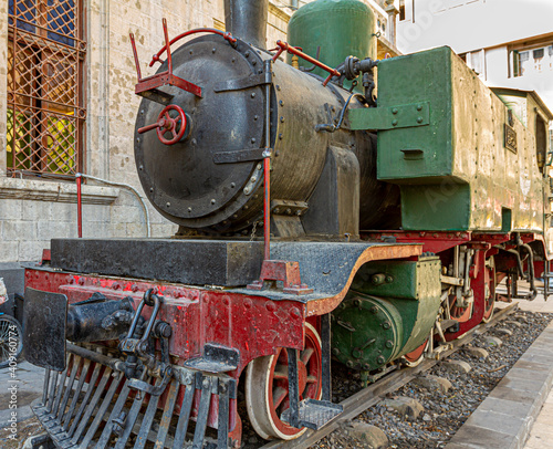 Photo Historic locomotive dating back to 19th century seen on display in front of the famous former Hejaz Railway Station in Damascus, Syria