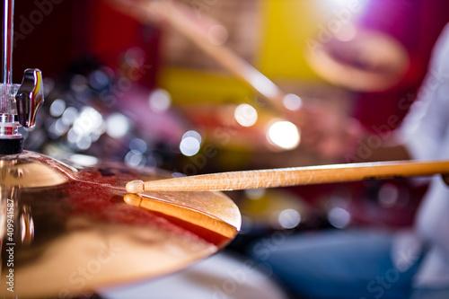 Fototapeta indian man playing the drums sticks close-up in recording studio