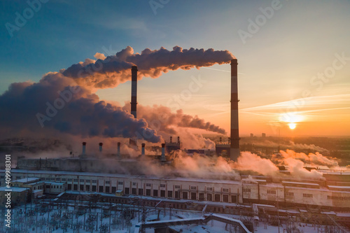 Foto Industrial factory pollution, smokestack exhaust gases