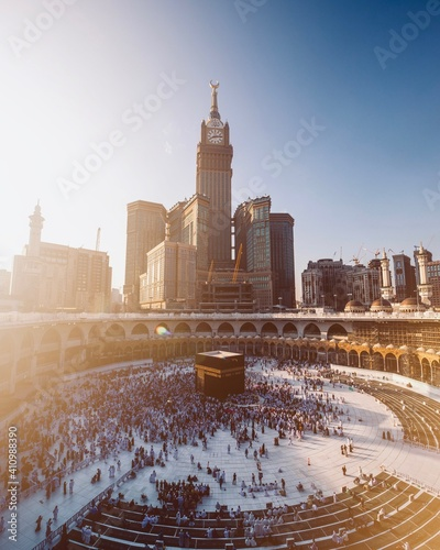 High Angle View Of People In Mecca By Modern Buildings Against Clear Sky