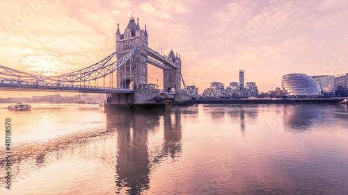 Fotografie, Obraz View Of Bridge Over River In City Against Cloudy Sky