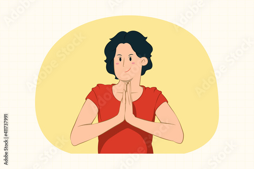 Fototapeta Young woman holding hands folded in prayer concept