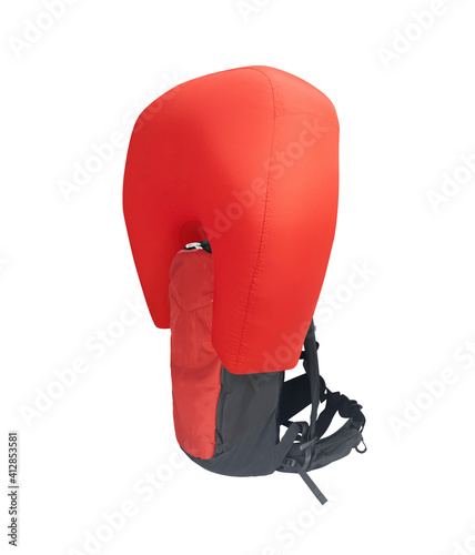Foto Side view of red inflated avalanche airbag backpack isolated on white background