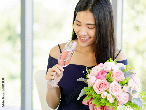 Wallpaper Mural A beautiful young cute black long hair Asian woman with a rose bouquet in hand h