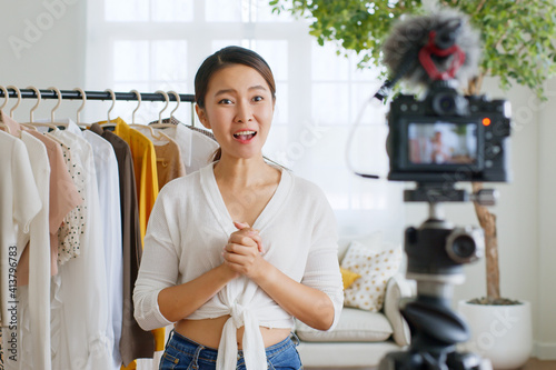Fotografija Asian woman influencer seller broadcast live streaming to sell clothes for onlin