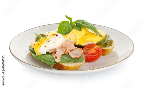 Fotografiet Plate of tasty sandwiches with florentine egg and bacon on white background