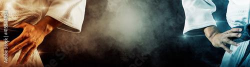 Cuadros en Lienzo Martial arts masters on dark smoke background