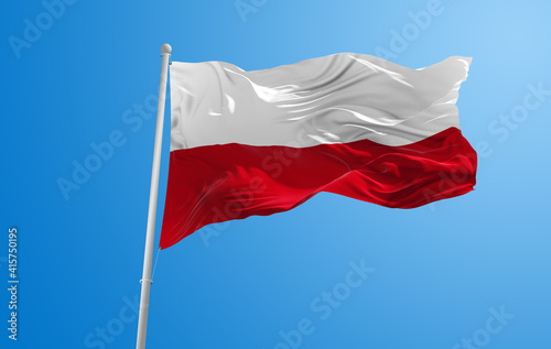 Wallpaper Mural Large flag of poland  waving in the wind on flagpole against the sky with clouds on sunny day