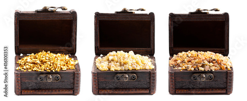 Fotografia Gold Frankincense and Myrrh in three Chests on a White Background