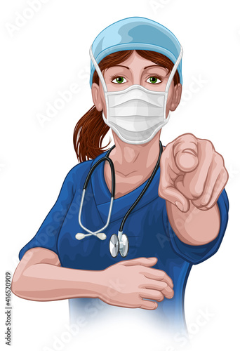Photo A woman nurse or doctor in surgical or hospital scrubs and mask pointing in a your country needs or wants you gesture