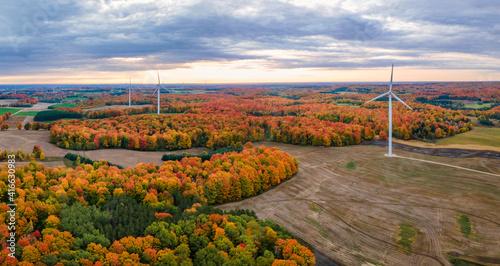 Canvas Print Autumn sunrise with wind turbines in central Michigan farmland near Cadillac Mic