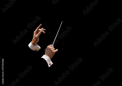 Foto Conductor's hands on a black background