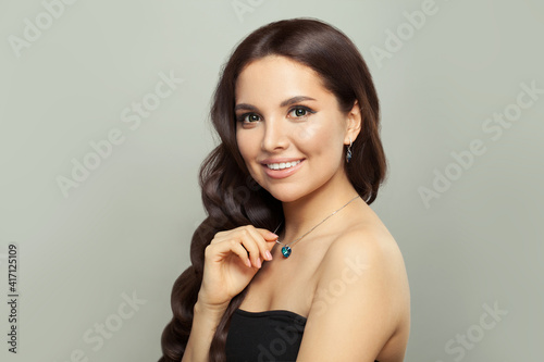 Fototapeta Attractive jewelry model woman in necklace and earring on white background