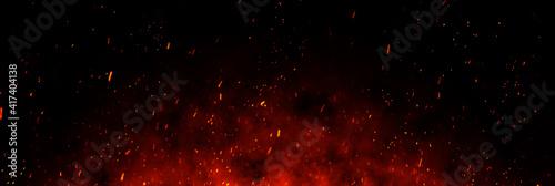 Obraz na plátně Fire embers particles over black background