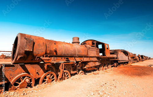 Old rusty steam train near Uyuni in Bolivia. Cemetery trains. Fototapeta