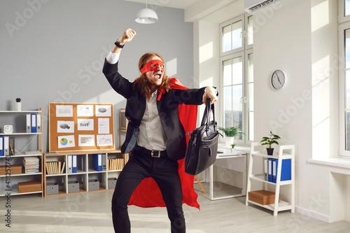 Платно Joyful superhero businessperson or corporate employee dancing and fooling around