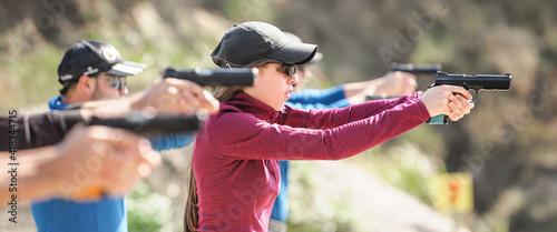 Fotografia Young people on tactical gun training classes