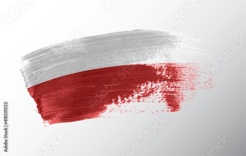Wallpaper Mural Poland flag illustrated on paint brush stroke