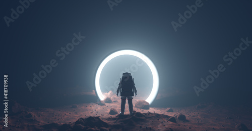 Astronaut on foreign planet in front of spacetime portal light Fototapeta