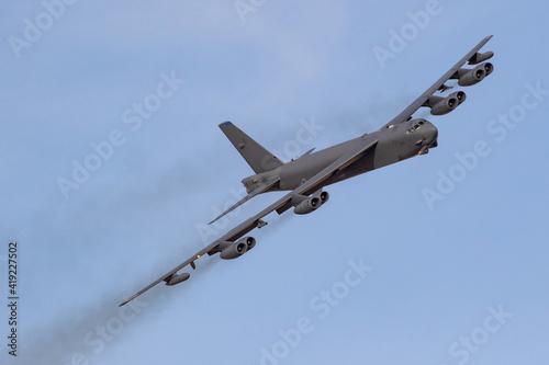 Fotografija B52 Bomber turns towards the camera on a sunny day, the eight engined bomber lea