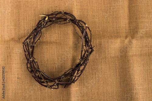 Fotografia, Obraz Crown of thorns on brown textile background.