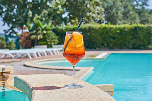 Close-up Of Drink In Wineglass On Poolside Fotobehang