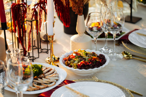Fotografiet Served outdoor banquet table with assorted oriental appetizers
