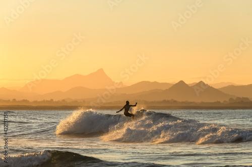 Surfing  at sunset, Byron Bay Australia Fototapeta