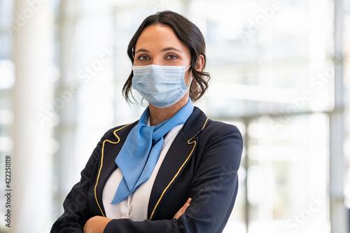 Air hostess wearing face mask during virus pandemic Fototapet