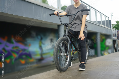 female Legs and bmx bicycle on bmx park background. фототапет