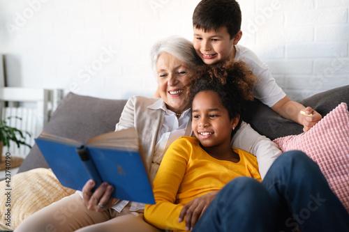Obraz na plátne Multiethnic diverse family. Senior grandmother teaching children