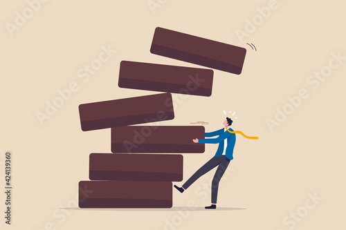 Investment risk, failure or mistake for greedy decision, business strategy to be careful and balance on instability and uncertainty concept, businessman pulling wooden block from collapsing stack Fototapet