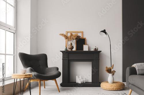 Obraz na plátne Interior of stylish living room with fireplace