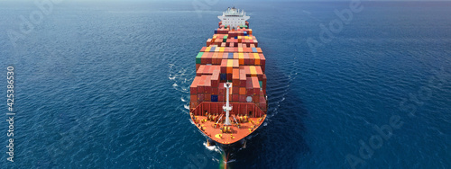 Fotografia Aerial drone ultra wide photo of huge container ship cruising deep blue open oce