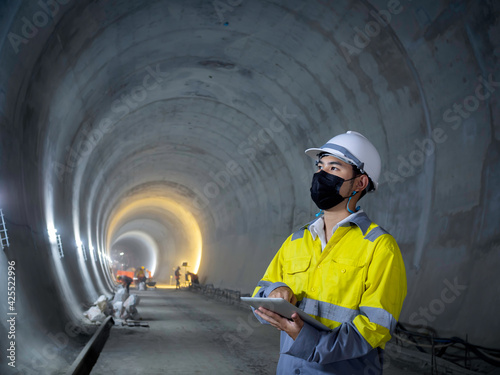 Young Asian tunnel engineering working at construction site. Fototapet